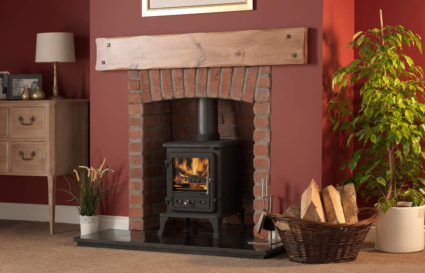 "Firefox 5.1 Multi-Fuel Stove with Rustic Brick Chamber with Front Returns and Arch, Slabbed Granite Hearth, Slabbed Granite Back Hearth, 54"" Croft Pine Beam"