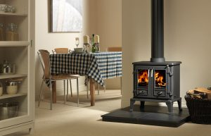 """Firefox 8TD Multi-Fuel Stove Shown with 36"""" x 36"""" Slabbed Slate Hearth and Bampton Log Basket"""