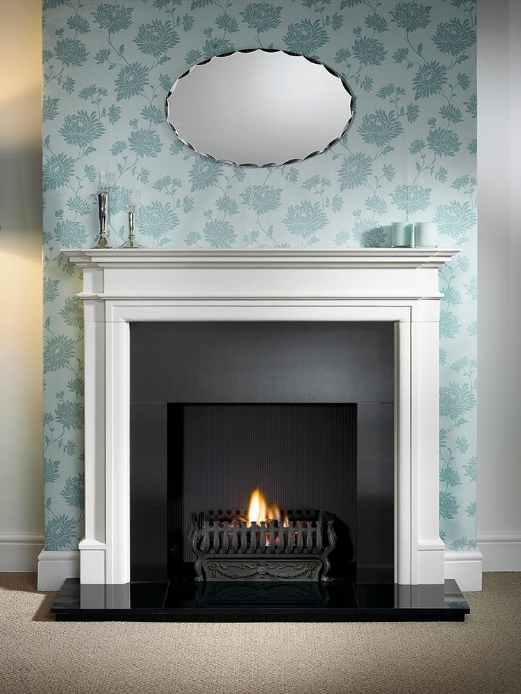 """Bartello 54"""" Agean limestone mantel with 21"""" Valencia fire basket with no back in black, real coal fire, granite slips, black painted reeded fireboard chamber, 54"""" slabbed granite hearth and slabbed granite back hearth"""
