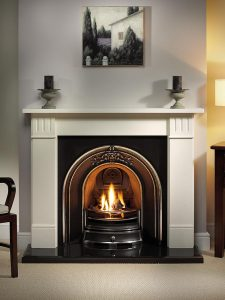 """Clarendon 56"""" Agean limestone mantel with Landsdowne highlight arched insert, decorative gas fire with ceramic coals and 54"""" bevelled granite hearth"""