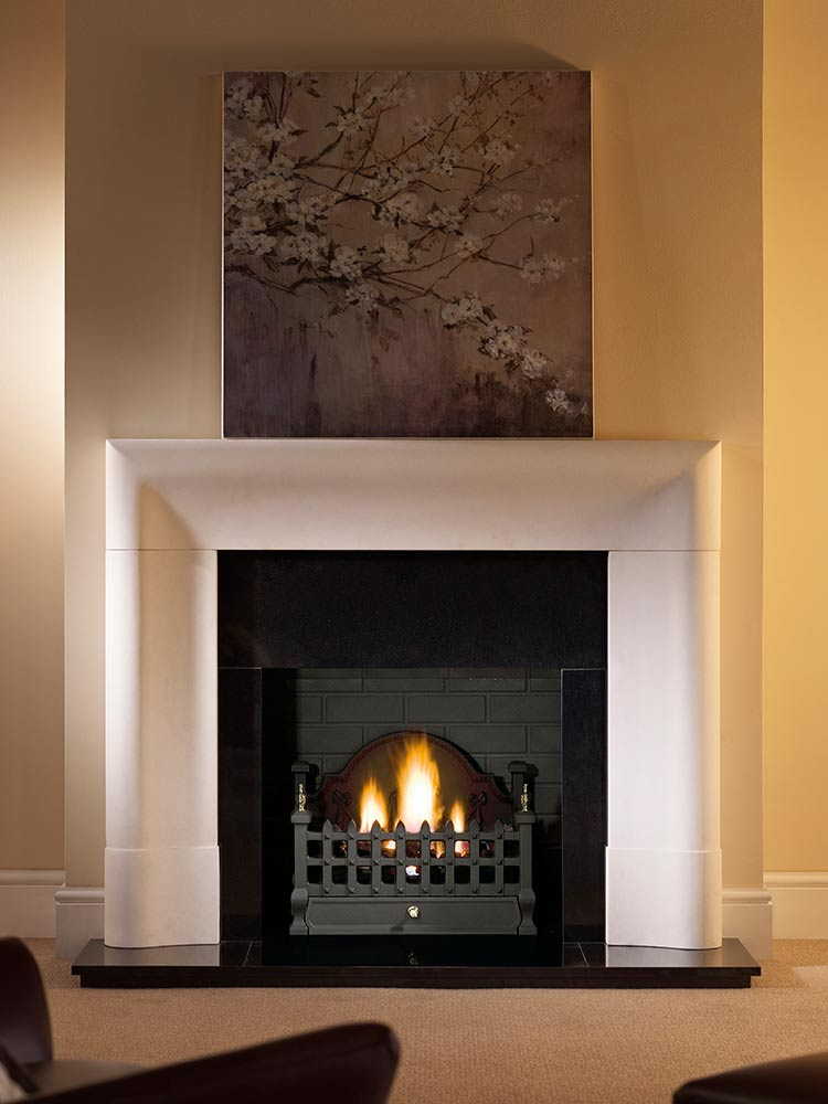 "Delection 56"" Agean limestone mantel with Castle fire basket in black, decorative gas fire with ceramic coal, granite slips, black painted reeded fireboard chamber, 60"" slabbed granite hearth and slabbed granite back hearth"