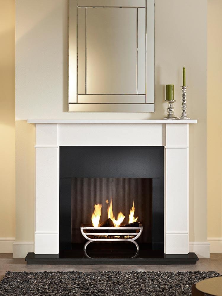 "Brompton 56"" Agean limestone mantel, Large Cradle polished fire basket, real log fire, granite slips, black painted reeded fireboard chamber, 54"" slabbed granite hearth and slabbed granite back hearth."