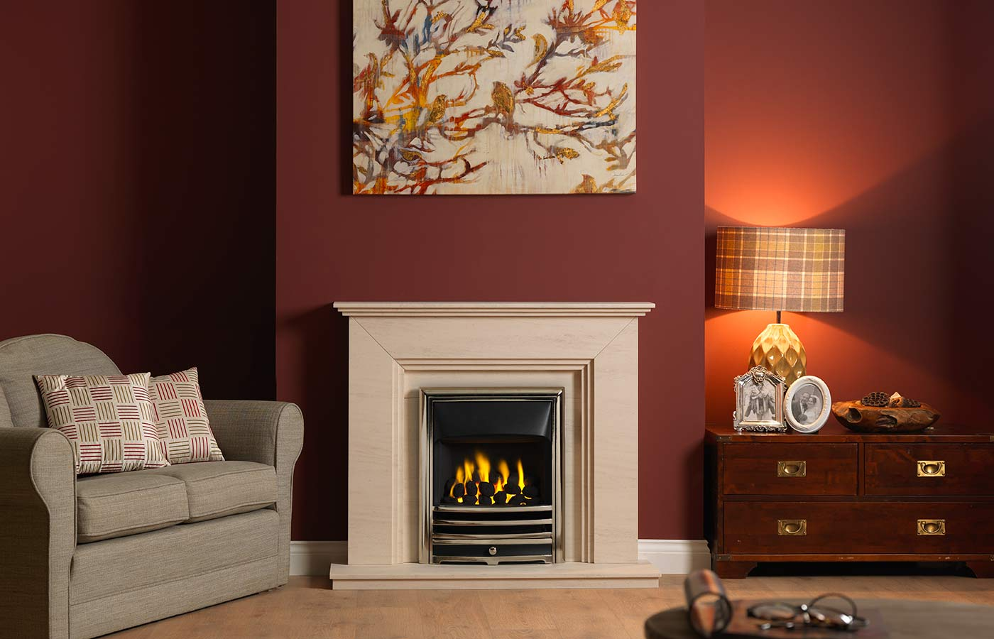 "Cranbourne 44"" surround in Portuguese limestone complete with Portuguese limestone back panel and 44"" hearth. Features a Bauhaus fire in antique brass finish"